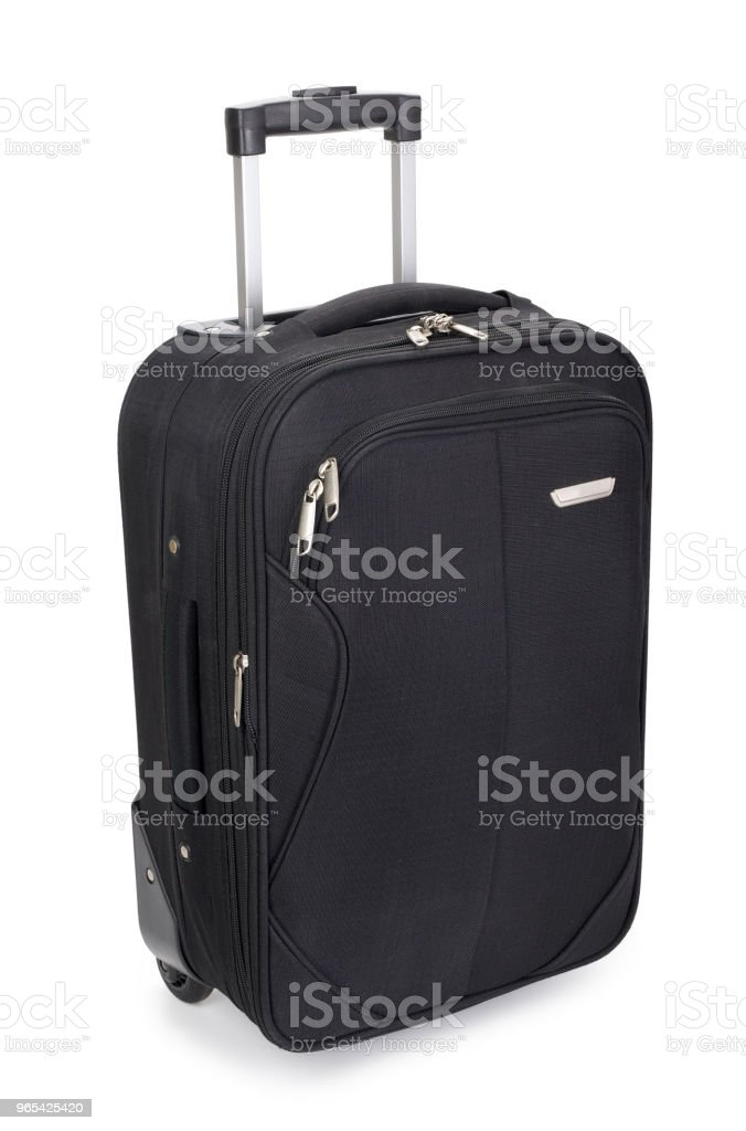 Black fabric suitcase isolated on white background, contains clipping path royalty-free stock photo