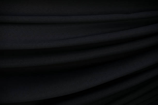 Black fabric wave abstract texture and  background stock photo