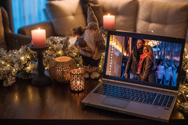 Black family calling on a Home Office Set Up for Webinar and Teleconference at Christmas stock photo
