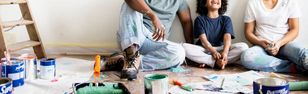 Black family painting house wall people home improvement stock pictures, royalty-free photos & images