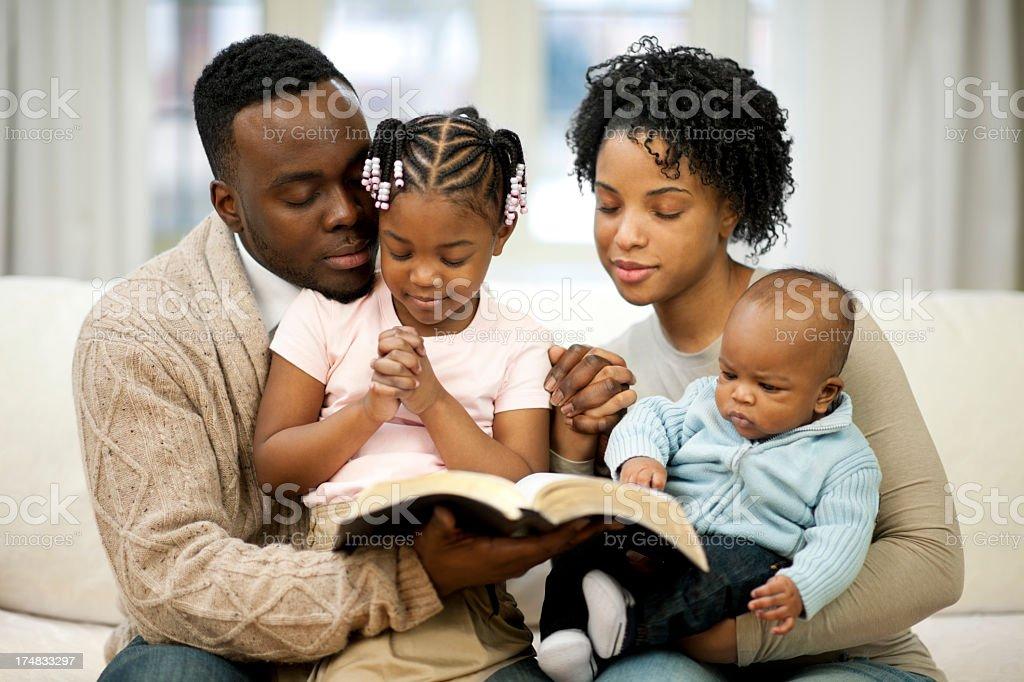 black family praying royalty-free stock photo