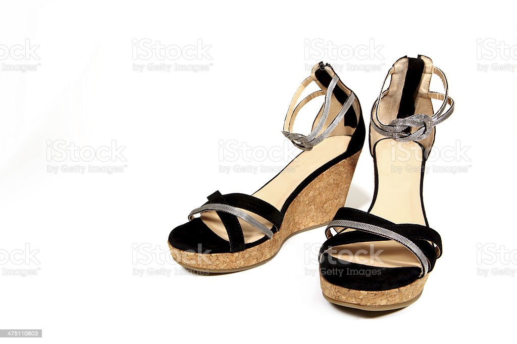 Black Fancy Wedge Sandals on White Background stock photo