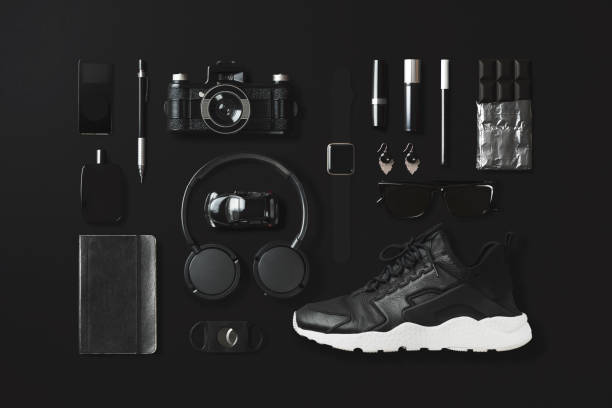 Black fashion and technology items flat lay on black background - foto stock