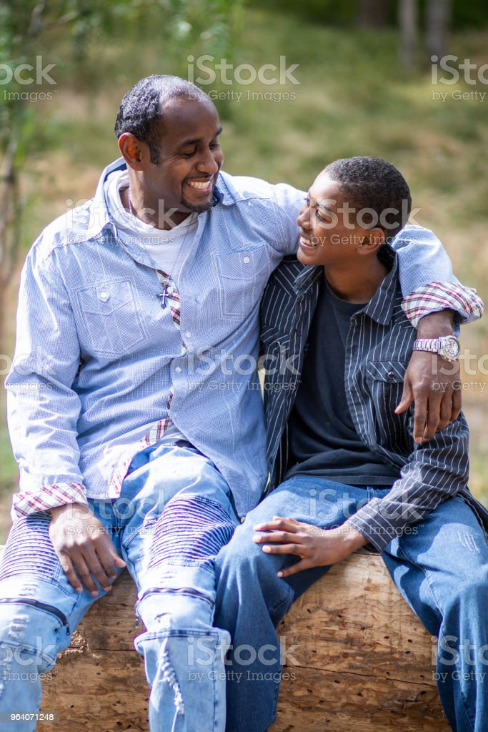 Black Father and Son Having a Conversation - Royalty-free Adolescence Stock Photo