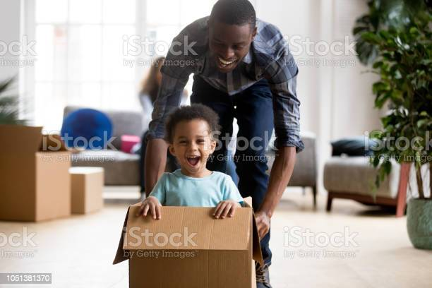 Black father and son playing with box at home picture id1051381370?b=1&k=6&m=1051381370&s=612x612&h=mbmfjupomnjbodjedxyedwyvpgraxxy ulc6dqvjpk4=