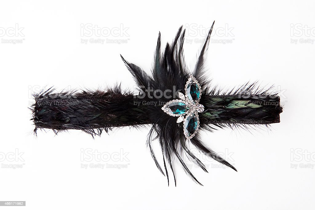 Black feather headband with jewelry stock photo