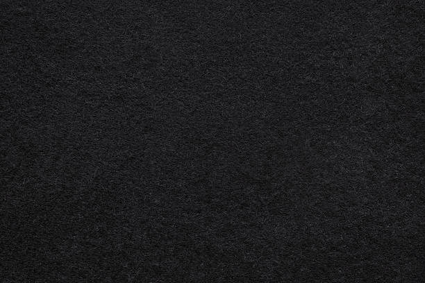 black felt background - velvet stock pictures, royalty-free photos & images
