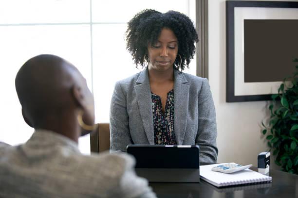 Black Female Businesswoman Lacking Motivation at Work stock photo
