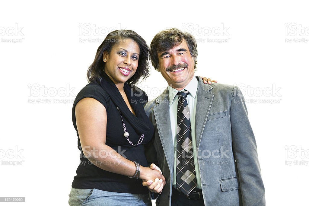 Black female businesswoman shaking hands with male colleague royalty-free stock photo