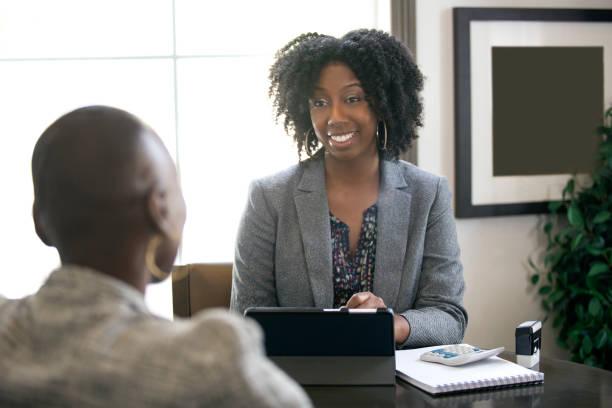 Black Female Businesswoman Tax Preparer or CPA stock photo