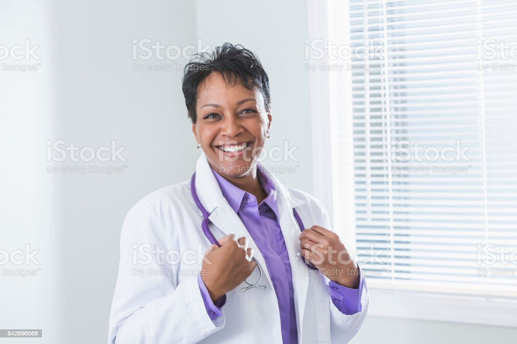 Black female doctor in lab coat stock photo