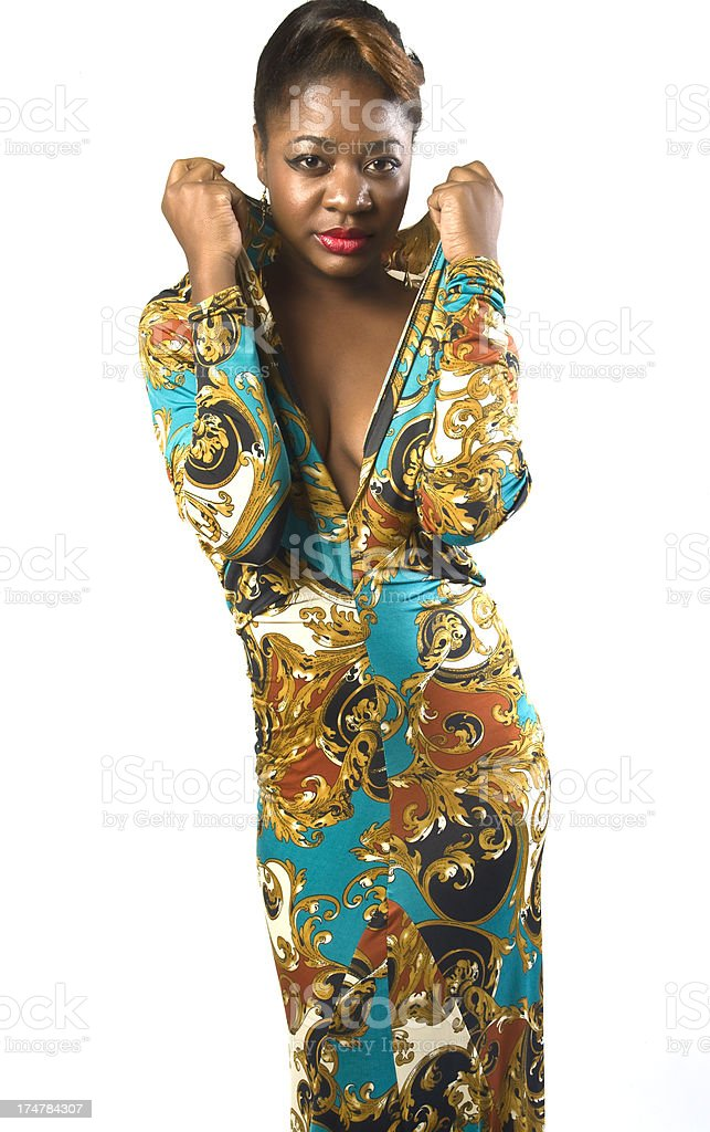 Black Female Fashion Model In Colorful Patterned Dress With Cleavage stock photo