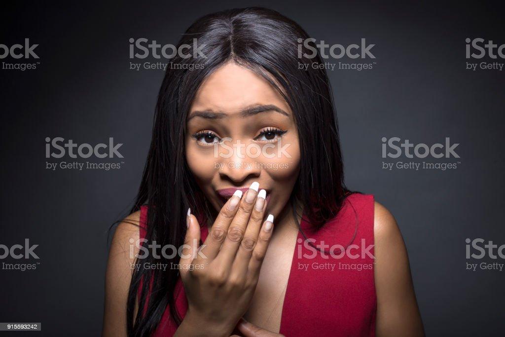 Black female on a dark background made a mistake stock photo