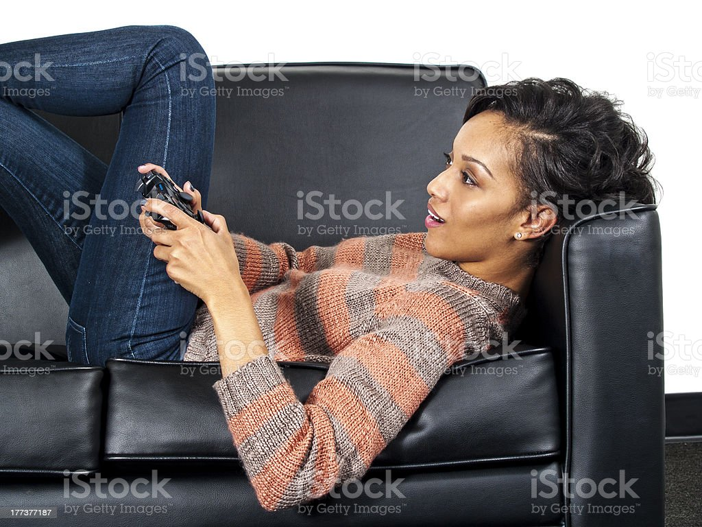 Black Female Playing Video Games and Lying Down royalty-free stock photo