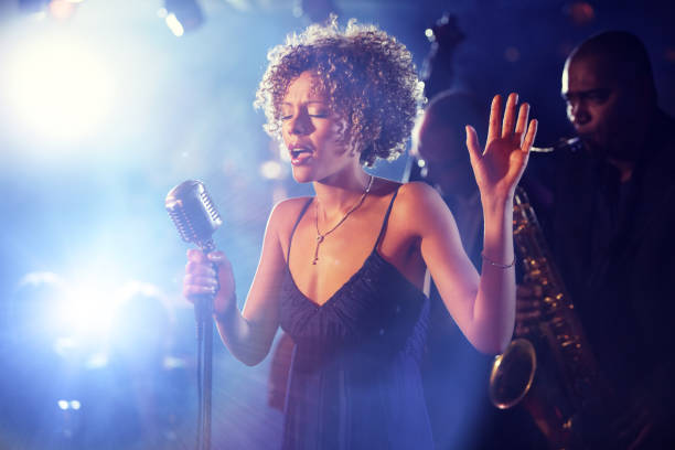 Black female Singer Performing on stage stock photo
