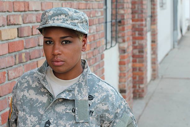 Black Female Soldier with Space for Copy Black Female Soldier with Space for Copy. mount combatant stock pictures, royalty-free photos & images