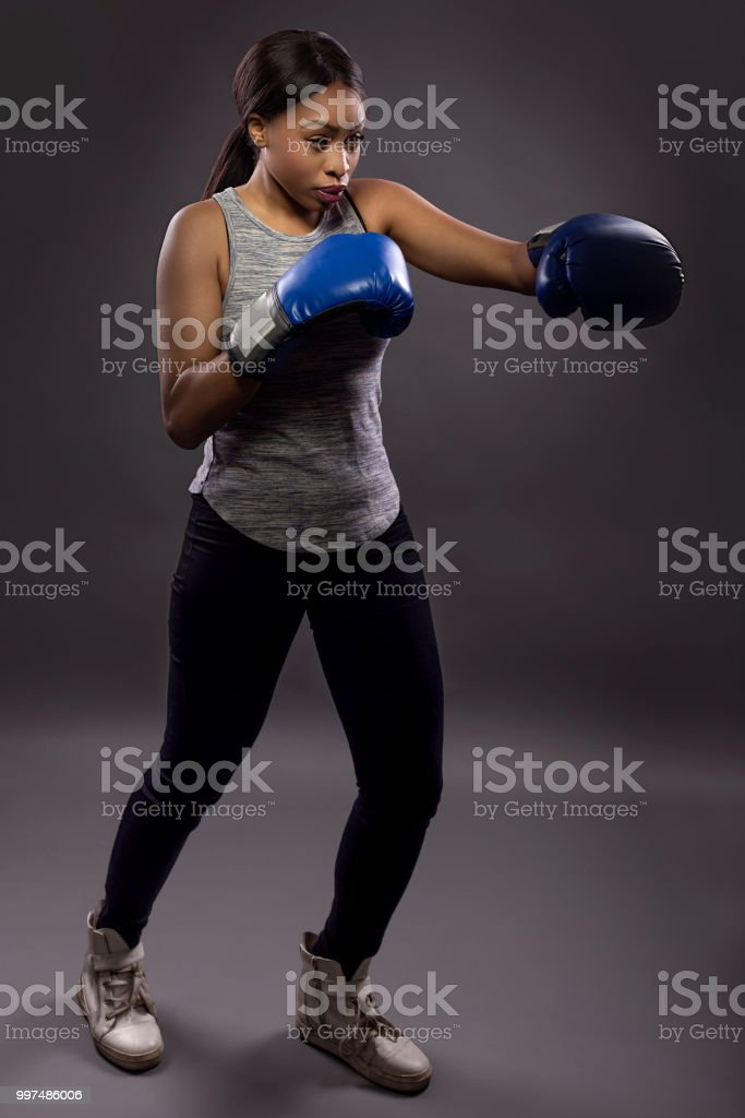 Black Female Training Boxing And Martial Arts Self Defense Stock