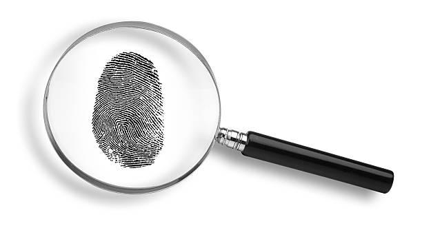 Black fingerprint under a magnifying glass on white stock photo
