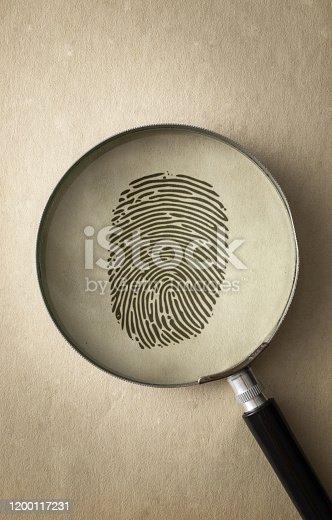 Black Fingerprint Under a Magnifying Glass