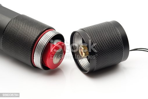 istock black flashlight opening the tail cap and have red alkaline battery inside on white background 936008294