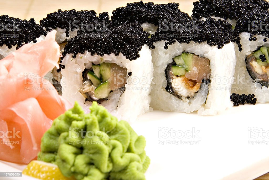 Black flaying fish caviar on California roll royalty-free stock photo