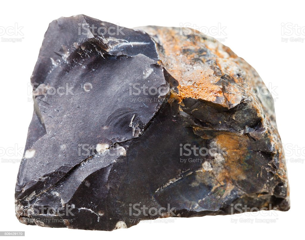 black flint (chert) crystalline rock isolated stock photo