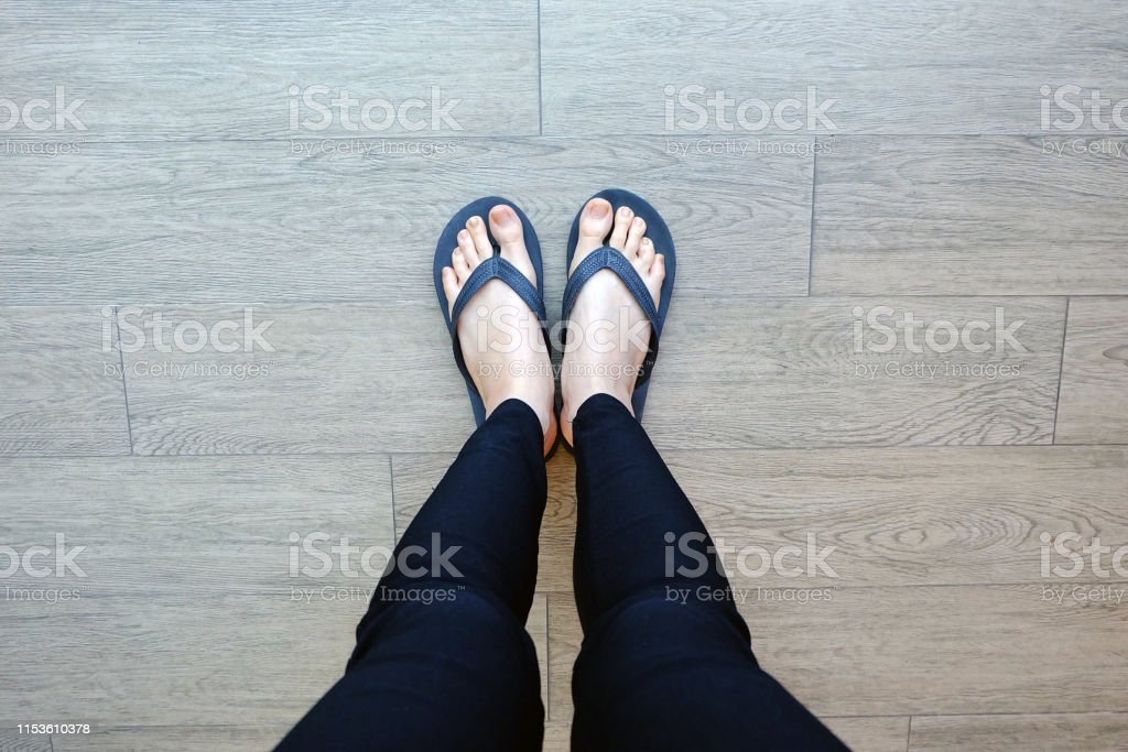 Black Flip Flops Isolated for Fashionable. Close Up of Legs Woman....