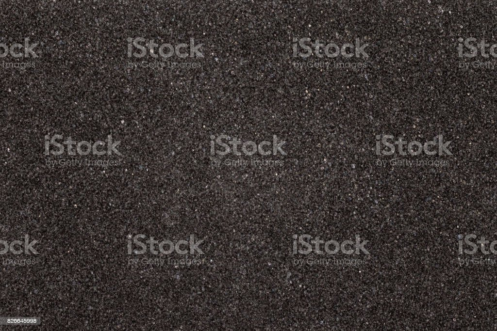 Black foam texture board. Soft rubber material background. stock photo