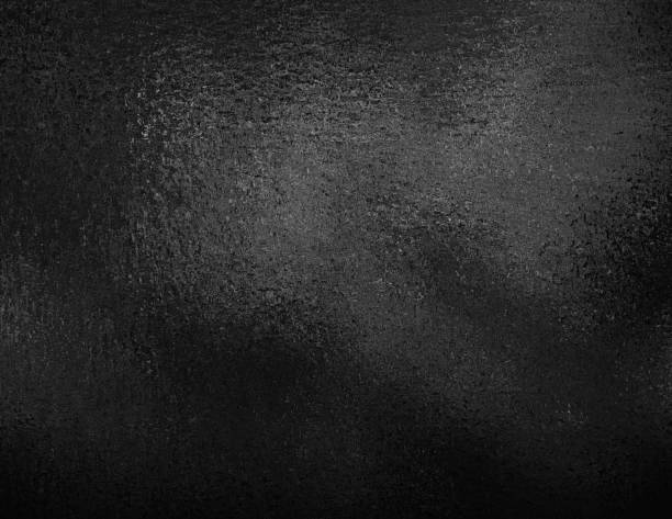Black foil textured background. Dark elegant smooth metallic texture. stock photo