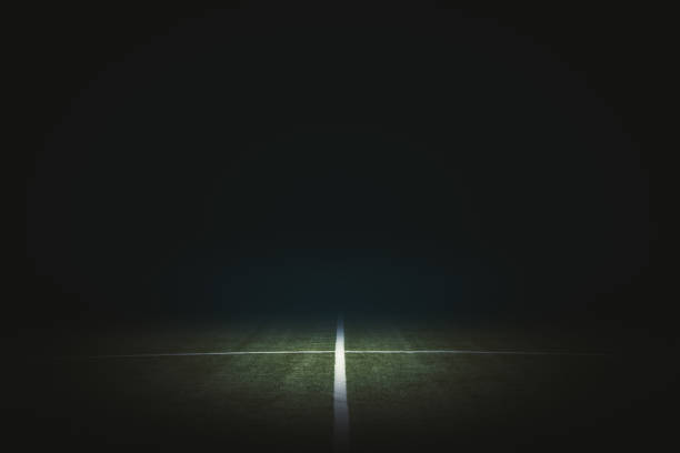 Black football field backdrop stock photo