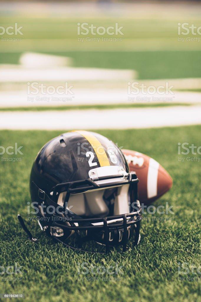 Black Football Helmet on Field stock photo
