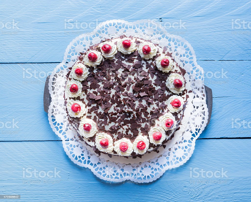 Black Forest cake on blue wood stock photo