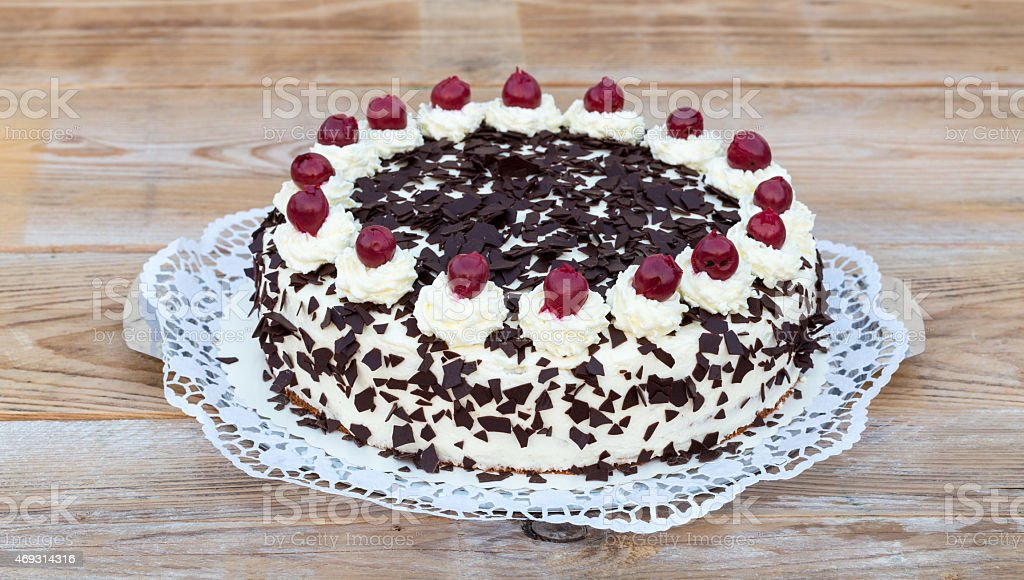 Black Forest cake on rustic wood stock photo