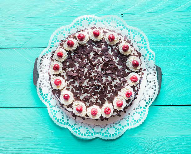 Black Forest cake on turquoise wood stock photo