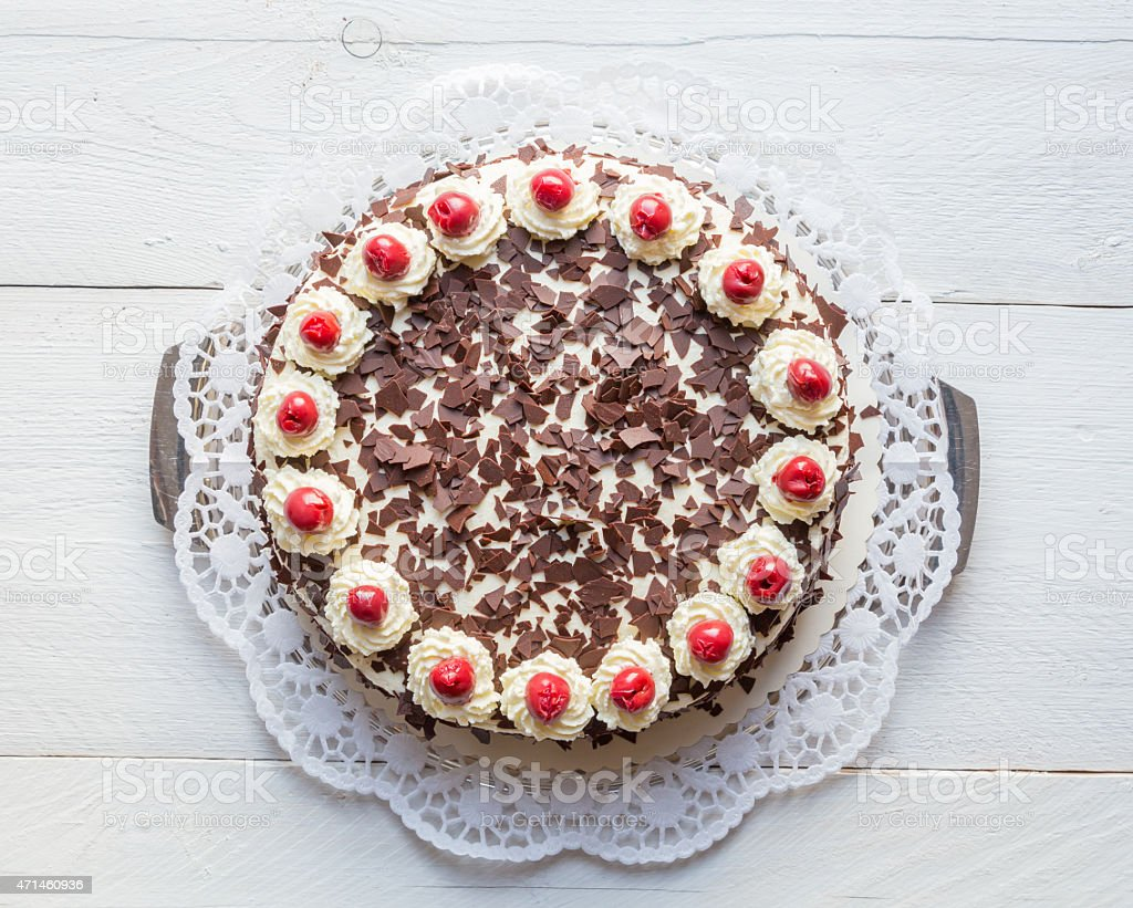 Black Forest cake on white wooden stock photo