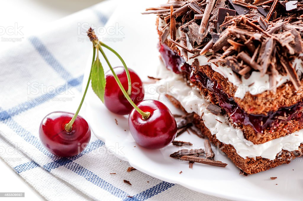 Black Forest cake piece with cherries berries stock photo