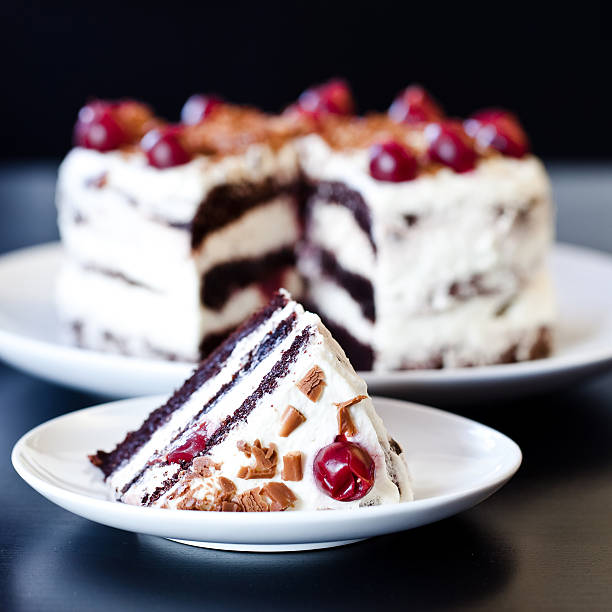 Black forest cake with whipped cream and cherries Traditional German cake with cherry and whipped cream. black forest stock pictures, royalty-free photos & images