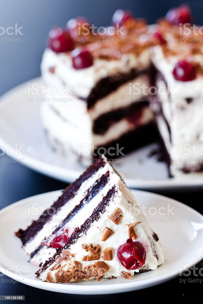 Black forest cake with whipped cream and cherries stock photo