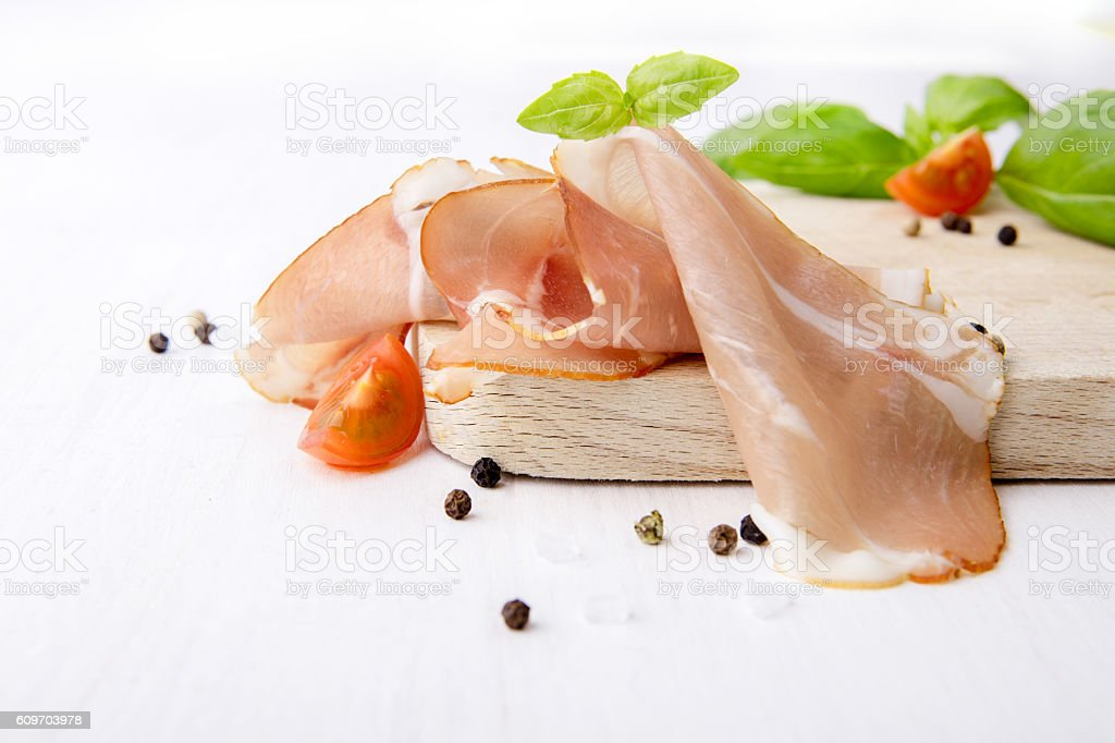 Black forest ham on wooden cutting board stock photo