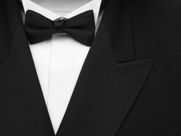 black formal dinner jacket and bow tie - tuxedo stock photos and pictures
