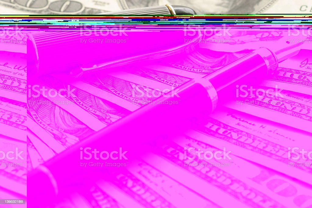 A black fountain pen laying on top of cash royalty-free stock photo