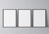 istock Black frame mock up. Frame poster standing on gray floor. Stock photo 1227360952