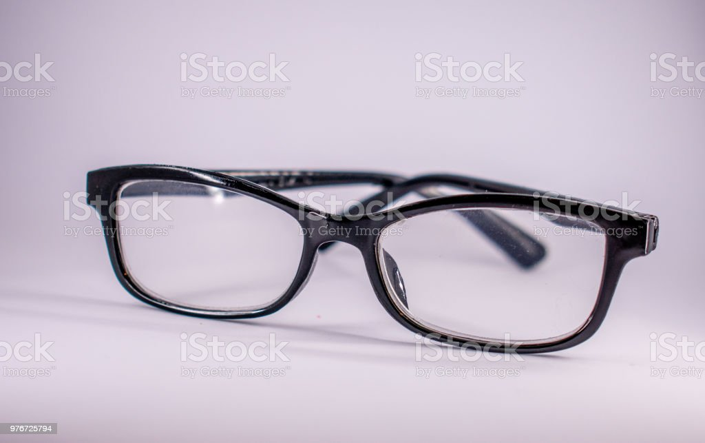 black framed plastic eyeglasses on white stock photo