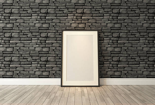 Black frames decor with black natural brick wall, background, template stock photo