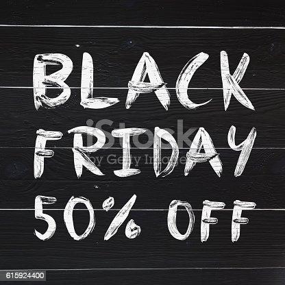 istock Black friday 50% off brush hand lettering on white 615924400