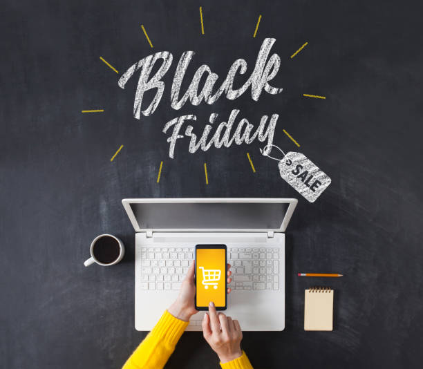 black friday advertisement on blackboard. woman shopping with smart phone app. - black friday imagens e fotografias de stock