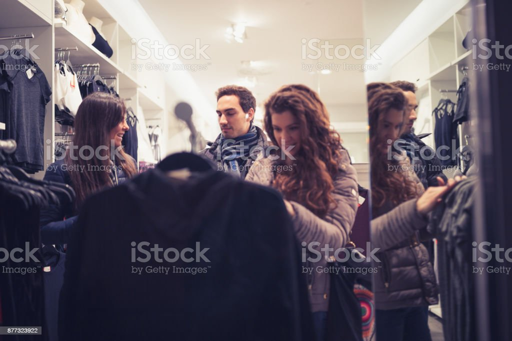 Black Friday Best Friends In Shopping Choosing Clothes In Fashion Store Stock Photo Download Image Now Istock