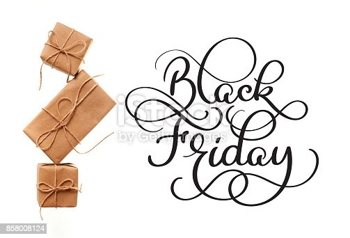 istock Black Friday calligraphy text on white background and gifts. Hand written 858008124