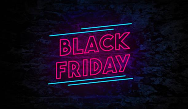 czarny piątek neon znak na ceglanej ścianie - black friday zdjęcia i obrazy z banku zdjęć