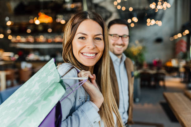 Black Friday Happy attractive loving couple enjoy shopping together shopping mall stock pictures, royalty-free photos & images